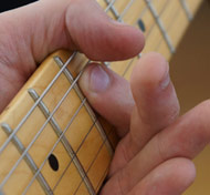 Guitar string muting